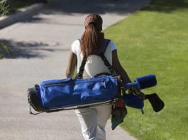 woman-carrying-golf-bag